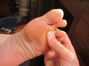 Learn how to massage under the toes!